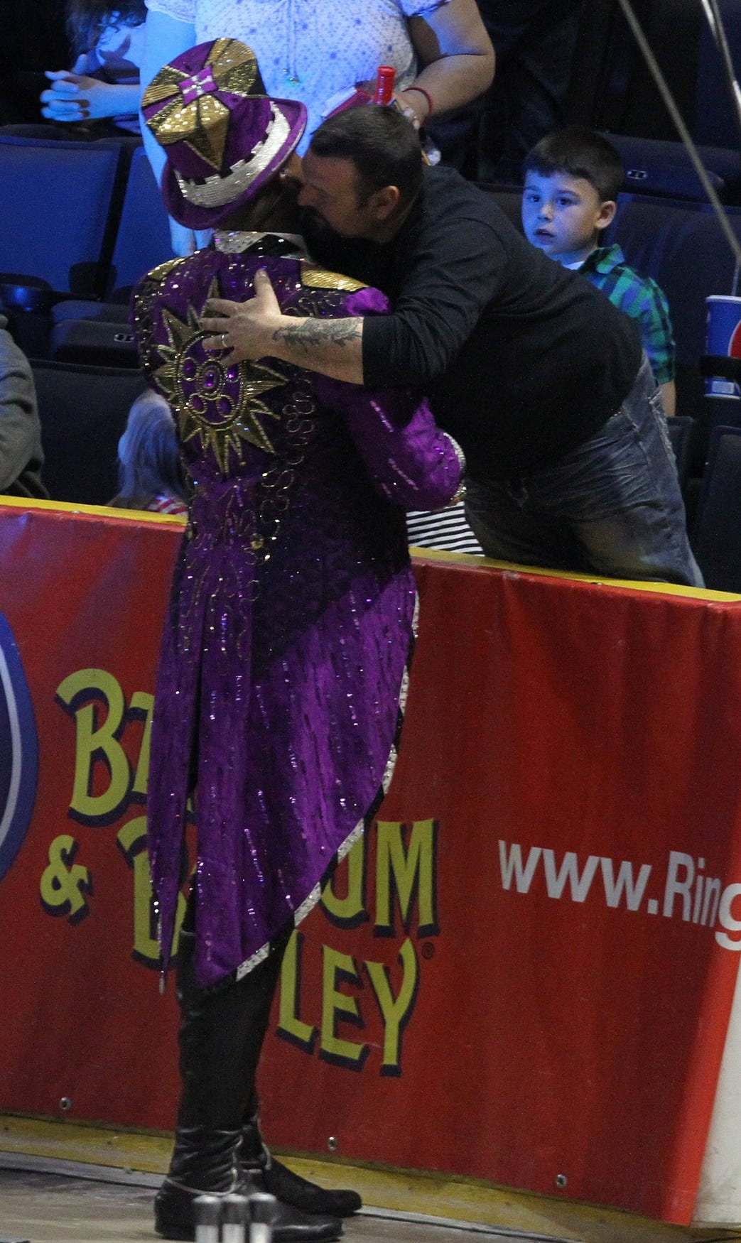 Johnathan Lee Iverson, Ringmaster of the Ringling Bros. and Barnum & Bailey LEGENDS was hugged by someone from the audience after he asked the crowd to leave, telling them they could not continue with the show.