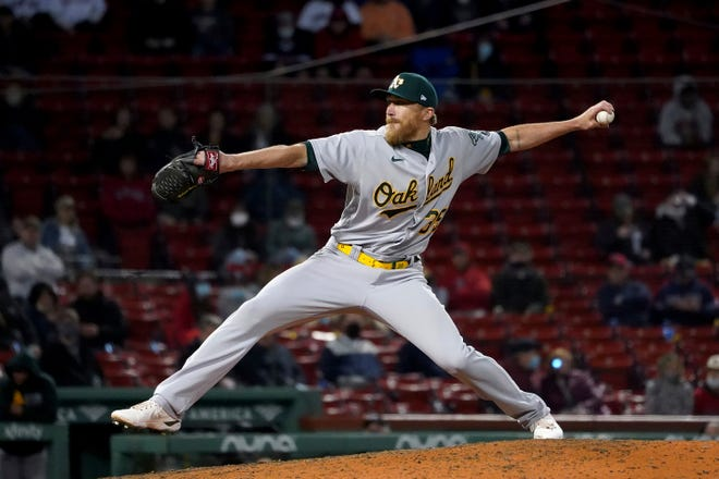 Oakland Athletics relief pitcher Jake Diekman throws during the ninth inning of the team's baseball game against the Boston Red Sox, Tuesday, May 11, 2021, in Boston. (AP Photo/Mary Schwalm) ORG XMIT: MAMS117