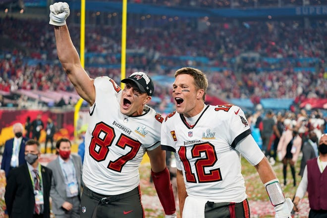 Published Caption:              Tampa Bay Buccaneers tight end Rob Gronkowski and quarterback Tom Brady rejoice in victory over the Kansas City Chiefs in the 55th Super Bowl on Sunday night. [Steve Luciano/AP] Original Caption:  Tampa Bay Buccaneers tight end Rob Gronkowski and quarterback Tom Brady rejoice in victory over the Kansas City Chiefs in the 55th Super Bowl on Sunday night.
