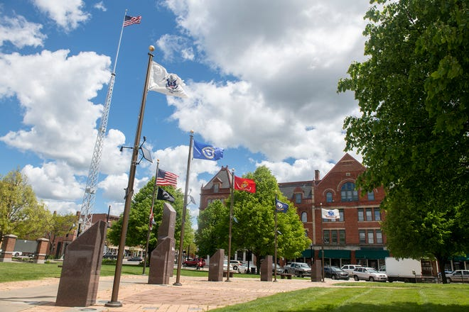The veterans memorial, located on the Ravenna courthouse lawn, won't be moving, a county commissioner said. A proposal by Main Street Ravenna suggests that the memorial could be moved next to the city's flagpole near Main Street.