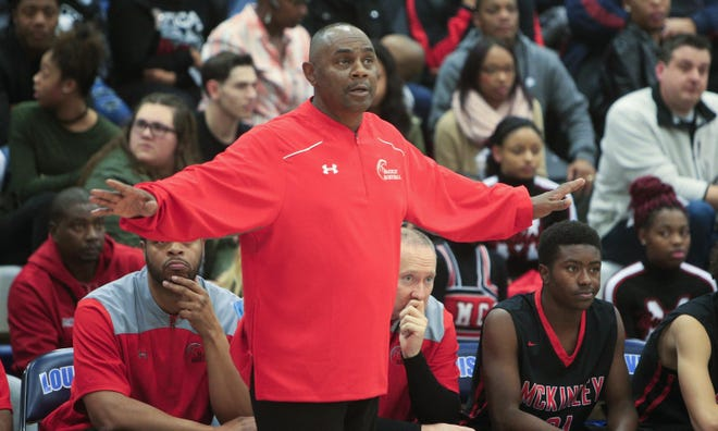 Rick Hairston coaches McKinley during a 2016-17 game at Louisville.