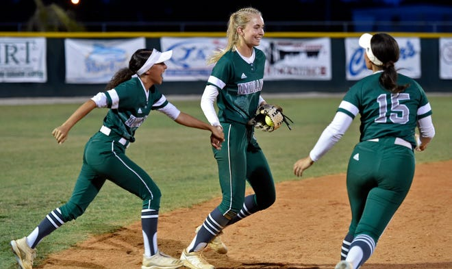 Venice High's Micaela Hartman (14) celebrates the final out in the seventh inning winning the game over Sarasota by a score of 3-2 at Venice on Tuesday night.