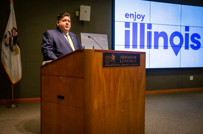 """Illinois Gov. JB Pritzker unveils the new """"Time For Me to Drive"""" campaign to jumpstart tourism in Illinois as the COVID-19 pandemic restrictions begin to ease during a press conference at the Abraham Lincoln Presidential Library  in Springfield, Ill., Wednesday, May 12, 2021."""