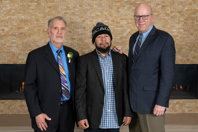John Hanlon, at right, with exoneree Angel Gonzalez and Illinois Innocence Project founding member Larry Golden, left. Hanlon, the IIP's executive director, is retiring June 30. [Courtesy of UIS]