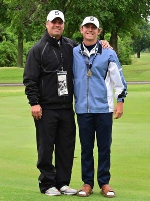 Shawnee's Gus Fritz (right) poses with SHS coach Doug Wells after Fritz finished third at the Class 5A State Golf Tournament on Tuesday.