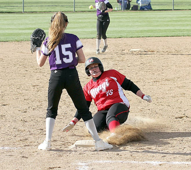 Jade Richards of Colon slides safely into third base against Athens in prep softball action on Tuesday.