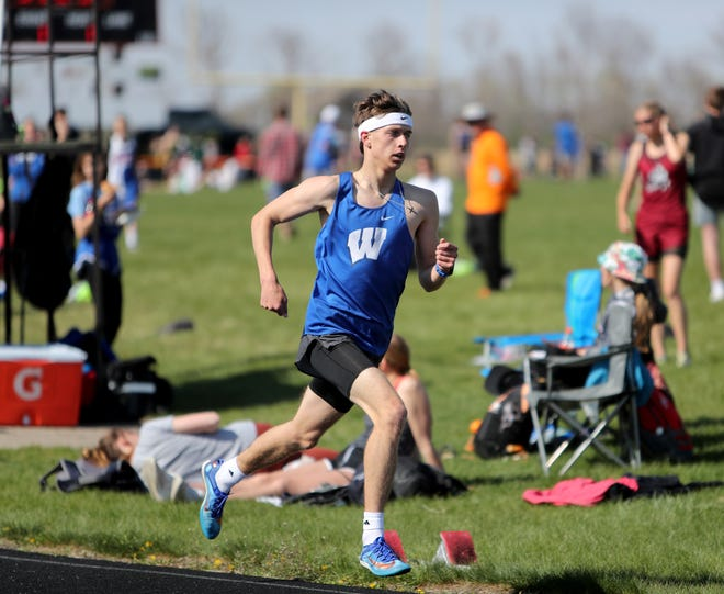 Warner miler Cody Larson breaks an unofficial record as he won the 1600 meter run at Tuesday's Lake Region Conference Meet in Ipswich. American News photo by Jenna Ortiz, taken 05/11/2021.