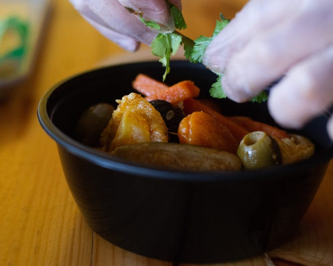 A garnish of parsley tops off a bowl of roast beef tagine by chef and owner Rida El Azri Ennassiri at Tagine.