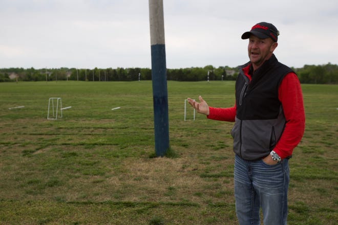 Brady Hight, co-owner of Pure Golf Topeka, stands near that facility's driving range while talking about the amenities Pure Golf will offer.
