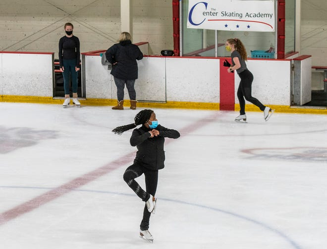 Khloe Kapinos, 11, of Worcester practices figure skating during class time at the Center Skating Academy Wednesday. The skating school operates in the New England Sports Center in Marlboro.