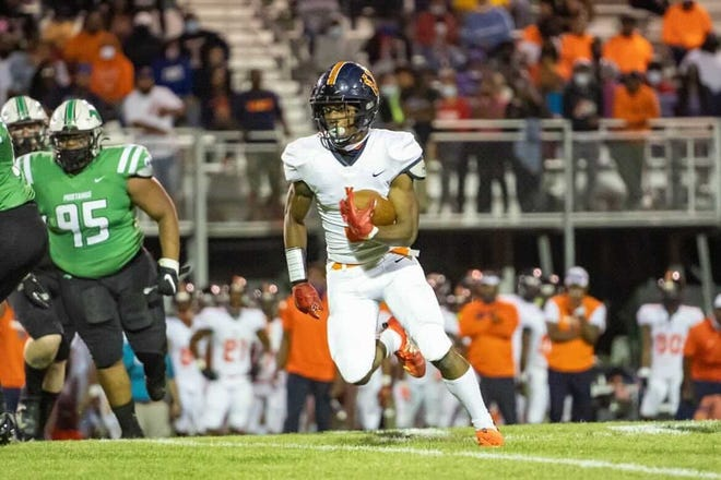 Vance sophomore running back Daylan Smothers (3) helped the Cougars win a second consecutive NCHSAA 4-AA state championship last weekend in Raleigh.