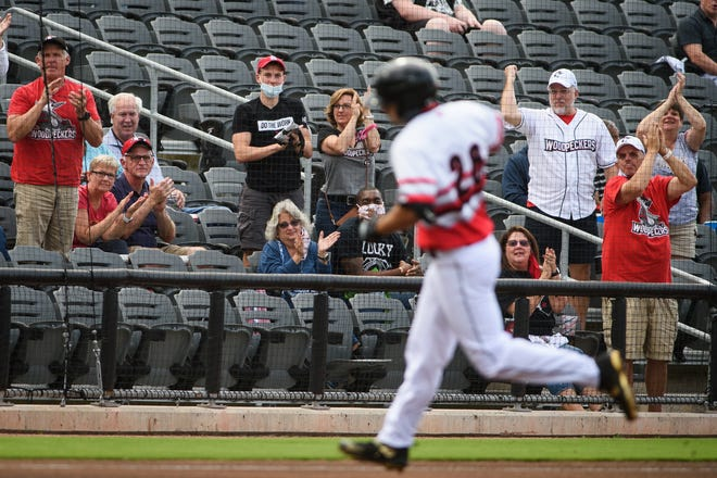Fans cheer on Fayetteville's Matthew Barefoot as he rounds the bases for a home run in the first inning against Kannapolis at Segra Stadium on Tuesday, May 11, 2021.