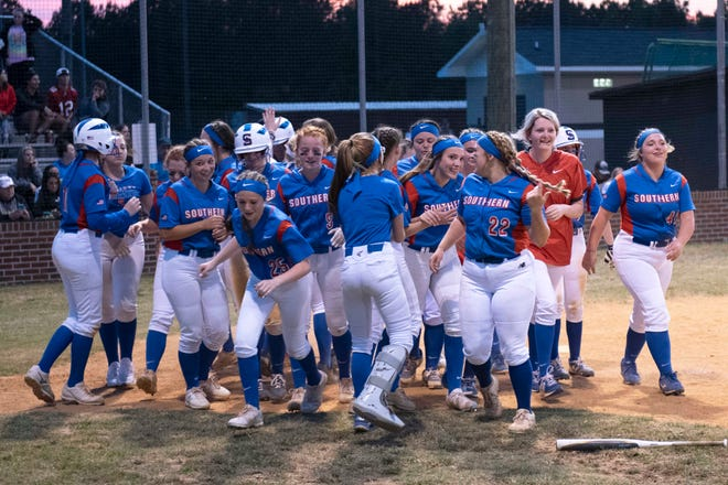 Southern Alamance celebrates after Isley Duggins hits a grand slam against Gray's Creek in Tuesday's NCHSAA 3-A East Regional Championship.