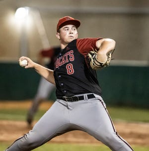 Baker County's Easton Stevens winds up a pitch against Arnold in an FHSAA baseball regional late Tuesday night.