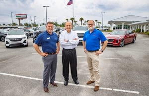 Bill Cramer and his sons, Chris and Will, plan to bring the first new car dealership to the Beach with the purchase of land along Panama City Beach Parkway. The Cramers were photographed at their dealership in Panama City on Tuesday, May 11.