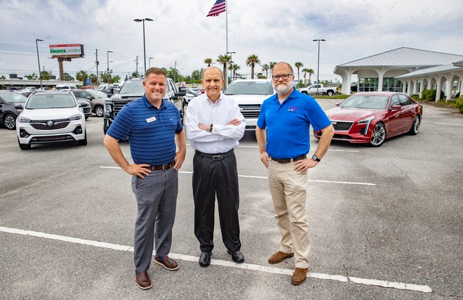 Bill Cramer, president ofBill Cramer Chevrolet Buick GMC (middle), stands with his sons Chris and Will. Cramer said he believes an employer-assisted housing program is a good idea, especially since housing and the ability to find employees are two main issues facing local businesses.