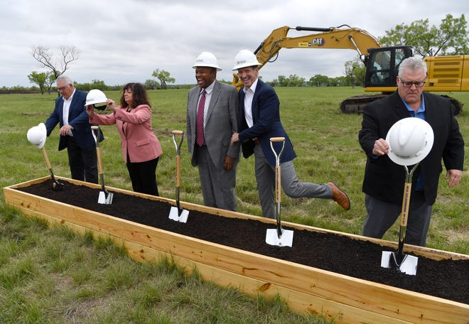 Great Lakes Cheese President and CEO Dan Zagzebski has a little fun with Abilene Mayor Anthony Williams as they ready themselves to ceremoniously break ground for the cheese company's new facility Wednesday.