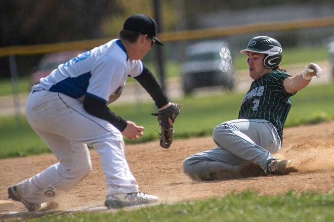 Harper Creek's Brayden Schwartz forces Pennfield's Seth Clothier out at third base on Tuesday, May 11, 2021 at Pennfield High School.
