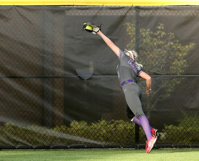 North Kitsap's Makayla Stockman snags a fly ball at the fence for an out during the 2021 Softball Showcase at Central Kitsap High School on Tuesday, May 11, 2021.
