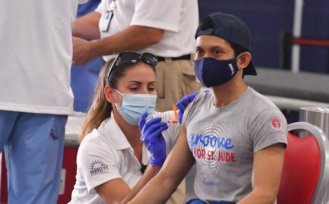 Registered nurse Kaitlin Shew gives cruise workers vaccine shots Wednesday at Cruise Terminal 6. Nurses from Parish Medical Center administered the Johnson & Johnson vaccine to 109 cruise ship workers from the Carnival Liberty.