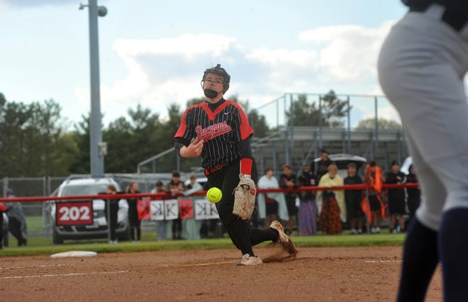 Bucyrus' Caleigh Rister slings a pitch to a Carey batter.