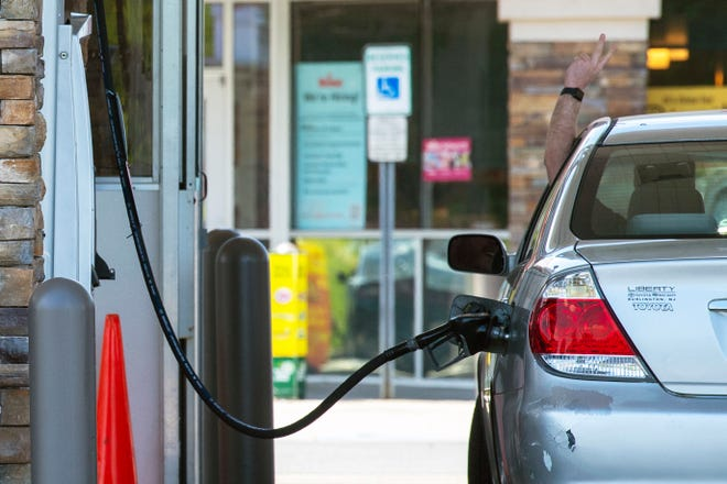 A car is filled up at a Wawa gas station in Pennsauken, N.J. on Wednesday, May 12, 2021.