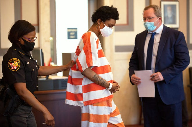 Sheriff's deputies bring Tianna Robinson, 25, into Judge Jody Luebbers courtroom in the Hamilton County courthouse for her arraignment on aggravated murder in the death of her 4-year-old daughter, Nahla Miller.