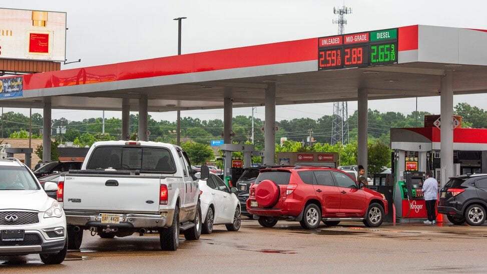 Drivers line up to fill their tanks with gas at the Kroger station in Jackson, Miss., Tuesday, May 11, 2021, after a ransomware attack Friday, May 7, 2021, shutdown the Colonial Pipeline, a critical artery for gasoline in the southeastern United States.