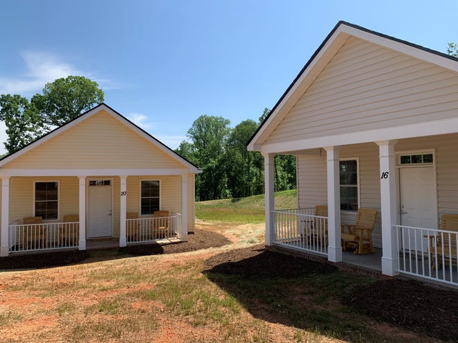 Two of Miracle Hill's new transitional homes at Restoration Way on Tuesday, May 11, 2021.