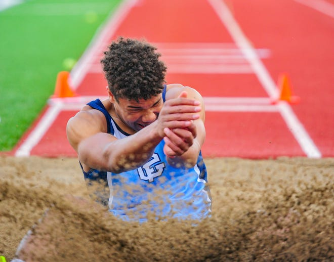 Great Falls High's Reed Harris compete's in the long jump during the crosstown track meet on Tuesday at Memorial Stadium.