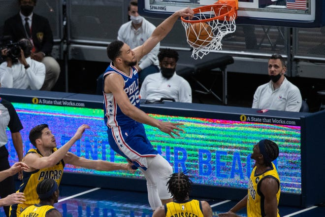 May 11, 2021; Indianapolis, Indiana, USA;Philadelphia 76ers guard Ben Simmons (25) slam dunks the ball in the first quarter against the Indiana Pacers at Bankers Life Fieldhouse.