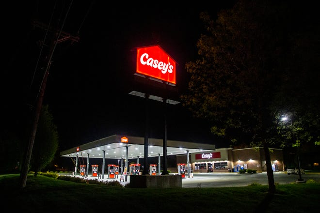 """Lights illuminate the canopy of the Casey's General Store at 1904 Broadway in Iowa City. The location had featured an armed security guard since 2018, a rare site at Casey's stores. After neighbors questioned why a guard was necessary, Casey's said it has """"paused"""" that activity and will reconsider the need."""