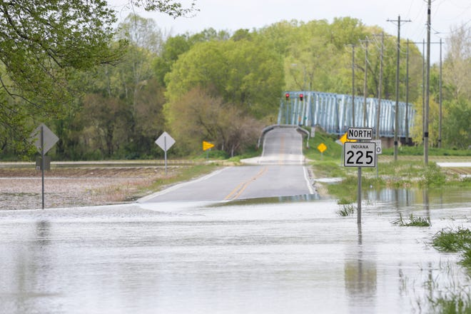 Water from the Wabash River flows over Indiana 225 near the Jewettsport Ford Bridge, Monday, May 10, 2021 in Tippecanoe County.