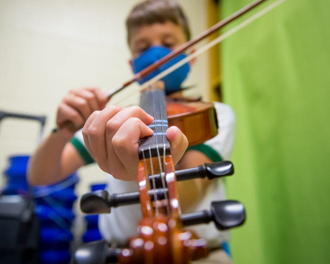 Clayton Broussard, 11, fifth-grader playing fiddle at LeBlanc Elementary in Abbeville Wednesday, May 12, 2021.