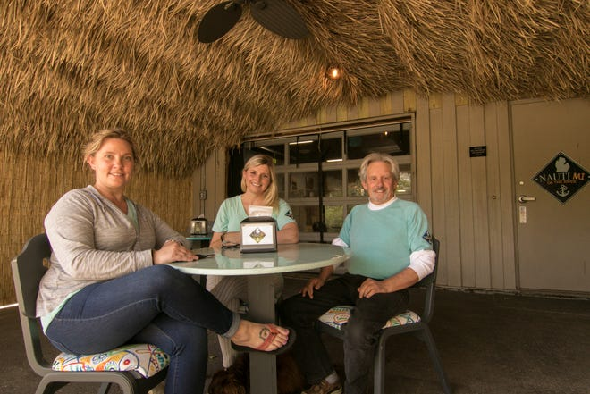 From left, Anna Teachworth, Melissa Kunnert and Kerry Klave, shown Wednesday, May 12, 2021 in their outdoor tiki area run NautiMI on the River in Dexter Township on the Huron River.