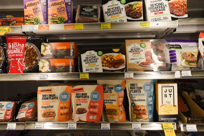 A cooler of vegetarian options and meat alternatives available at Foods For Living in East Lansing, pictured Wednesday, May 12, 2021