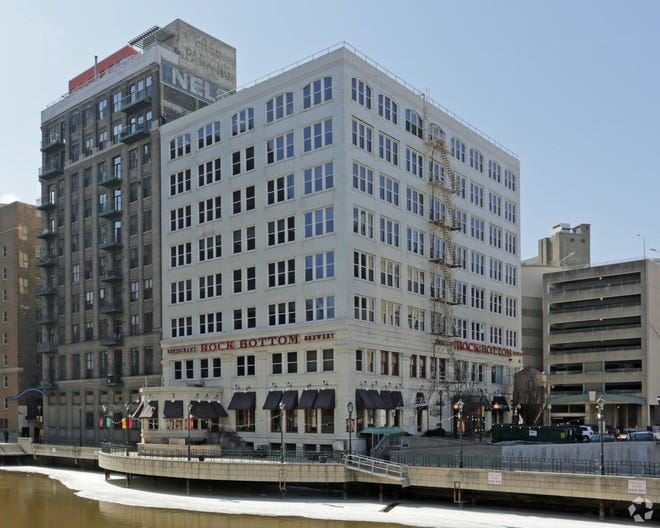 River Bank Plaza office building (right) will be converted into apartments.