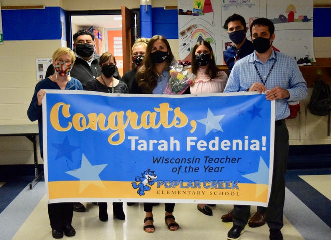 Tarah Fedenia (center, holding flowers) was one of five teachers in Wisconsin presented with the 2022 Wisconsin Teachers of the Year Award by the Wisconsin Department of Public Instruction.