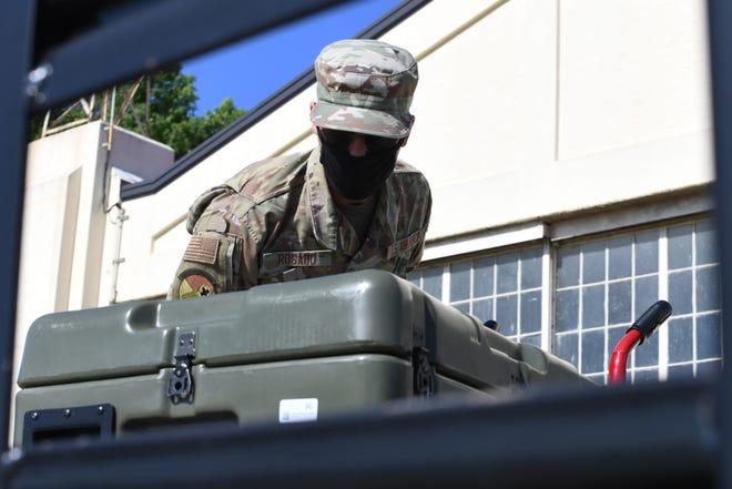 U.S. Air Force Airman Jorge Rosado, 42nd Medical Group Biomedical Equipment Apprentice, loads medical supplies onto a flatbed at Maxwell Air Force Base, Alabama, May 7, 2021.