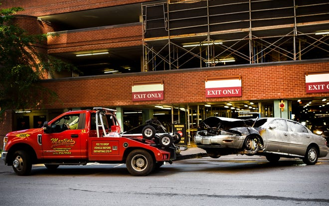 Martin's Wreck Service tows a fire-damaged vehicle from the East Garage at Vanderbilt University Medical Center in Nashville, Tenn., Wednesday, May 12, 2021.