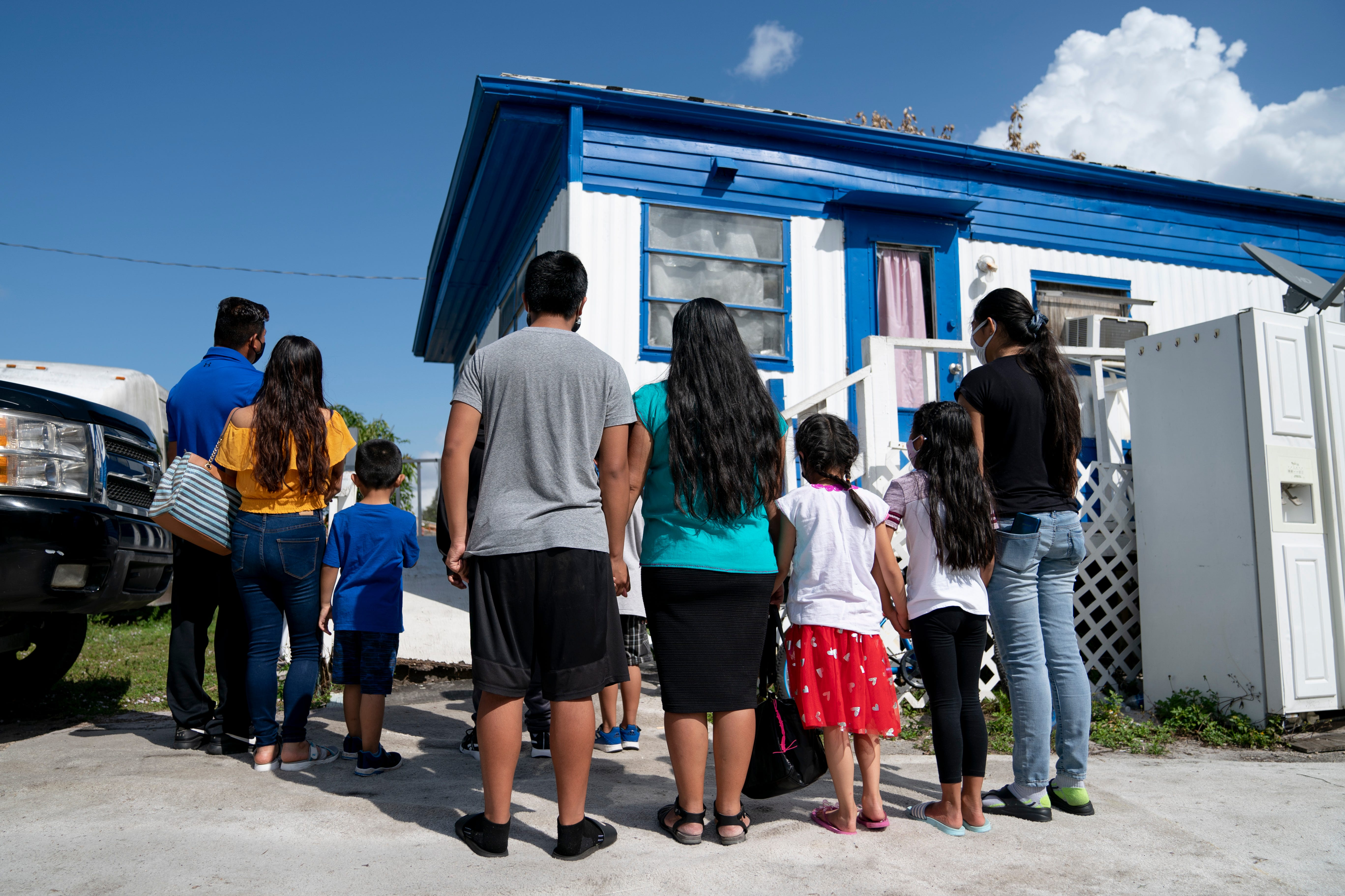 Families outside the Immokalee trailer where they used to live together.