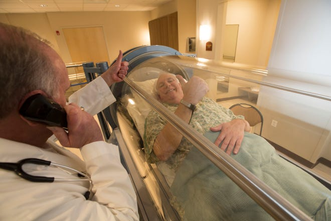 A patient receiving treatment in the hyperbaric oxygen chamber at the Institute of Wound Healing at Holy Name Medical Center. The non-invasive and painless therapy uses oxygen to help heal wounds that don't respond to other forms of treatment.