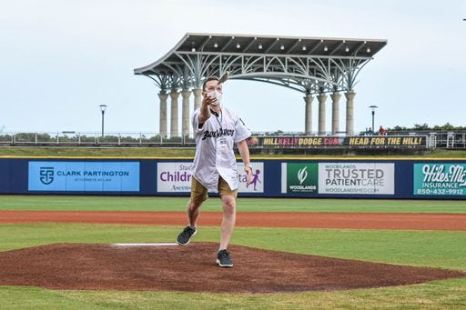 """WKRG-TV sports broadcaster Robby Baker threw out the """"First Fish"""" prior to the Pensacola Blue Wahoos' home opener against Birmingham on Tuesday, May 11, 2021 at Blue Wahoos Stadium."""