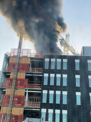 A fire started on the roof of the ISTB 7 building under construction on the ASU Tempe campus on May 11, 2021.