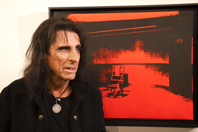 """Rock legend Alice Cooper will auction the red silkscreen on canvas from Andy Warhol's """"Little Electric Chair """"series. The artwork was recently discovered in a storage locker. Early estimates for the auction range from $2.5 to $4.5 million."""