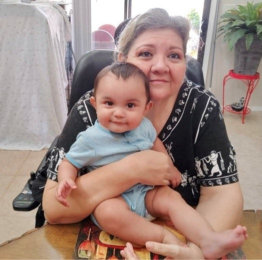 My mother, Pilar Corona, holds her grandson, Jiraiya James Ellsworth, after meeting him for the first time on April 18, 2021.