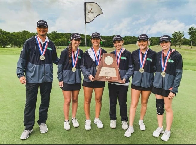 Wall High School's girls golf team along with coach Rob Londerholm pose with their championship trophy in Class 3A at the UIL State Golf Championships Tuesday in Manor.
