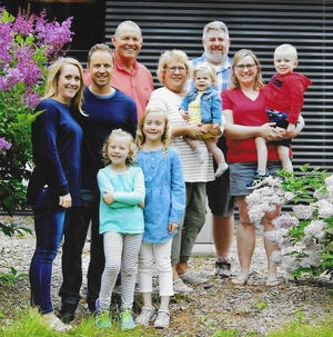 Cliff King with his family. In the front row are Cliff's granddaughters Kaelyn and Natalie King. In the middle row are Cliff's son, Tom King with his wife, Heather, and Cliff's wife, Karen, holding their granddaughter, Abigail Kramer, and Cliff's daughter, Megan Kramer, holding his grandson, John Kramer. In the back row are Cliff King and his son-in-law, Justin Kramer.