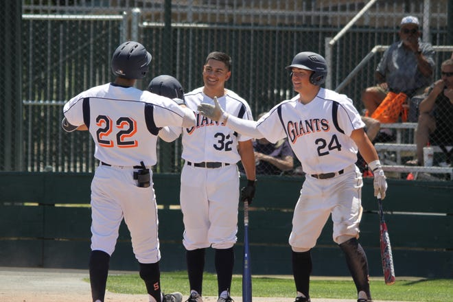 COS baseball player Donte Valdez (22) celebrates with Andrew Valdez (24) after a play.