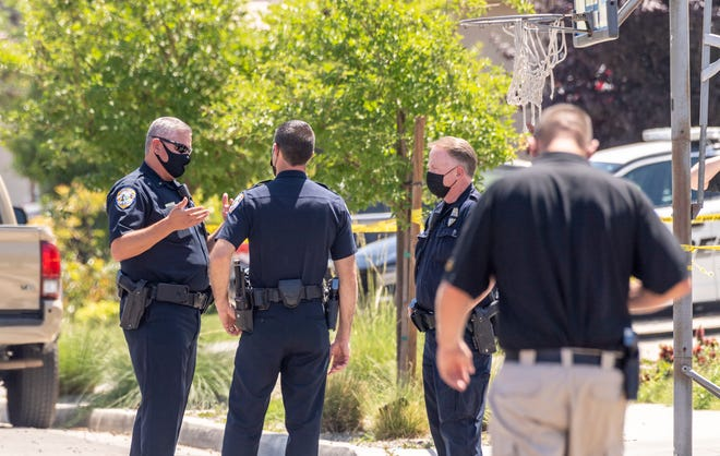 Visalia Police investigate a stabbing in the 6200 block of West Sweet Street on Wednesday, May 12, 2021. Police say the woman died after being stabbed her brother-in-law.